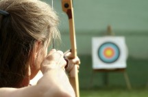 Archer spans the bow and aims to target.